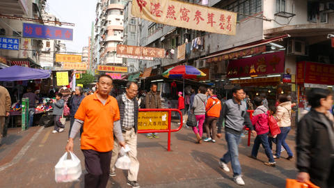 Entering pedestrian only area on street market Stock Video Footage