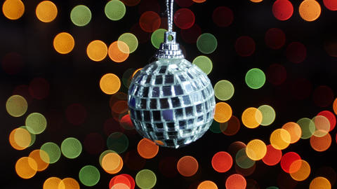Mirror ball rotates at background of bokeh lights Footage