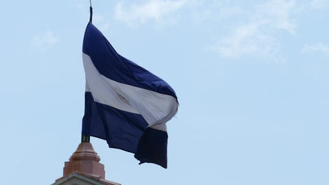 National flag of Nicaragua on blue sky Footage