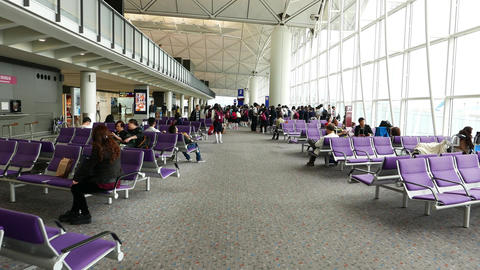 Large lounge area within HKG airport, POV walk forward, dolly-like shot Footage
