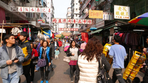 POV struggle forward along usual crowded street, cheap shopping area Footage