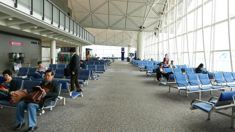 Walk through airside lounge, passenger seats, HKG... Stock Video Footage