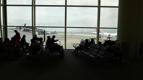 Passenger silhouettes departure gate lounge trucking shot... Stock Video Footage