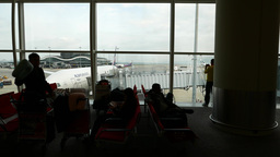 Waiting in airport gate lounge - passenger silhouettes,... Stock Video Footage