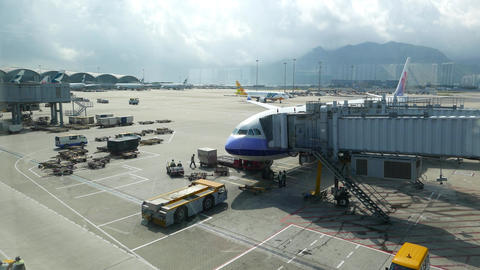 HKG apron area as seen from terminal, airplane connected... Stock Video Footage