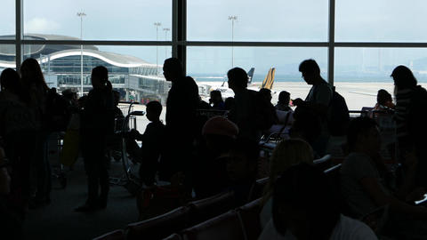Black figures passengers queue departure gate against... Stock Video Footage