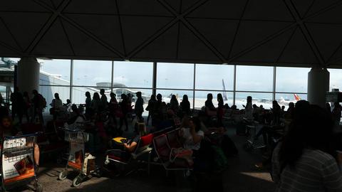 HKG terminal dark interior, sun spot, black silhouettes,... Stock Video Footage