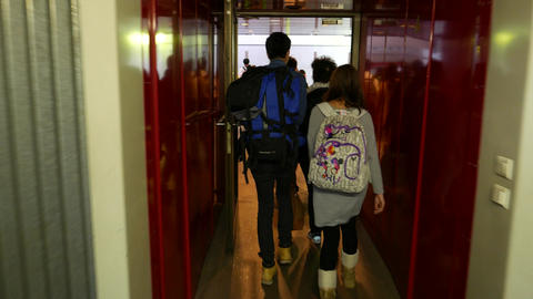 Young chinese couple walk through gangway door to airport... Stock Video Footage