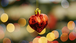 Christmas toy heart shakes at background bokeh Footage