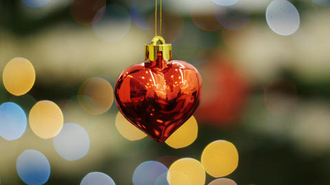 Christmas toy heart shakes at background bokeh Stock Video Footage