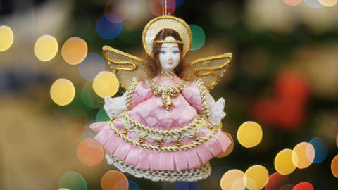 Christmas toy angel shakes at background bokeh Footage