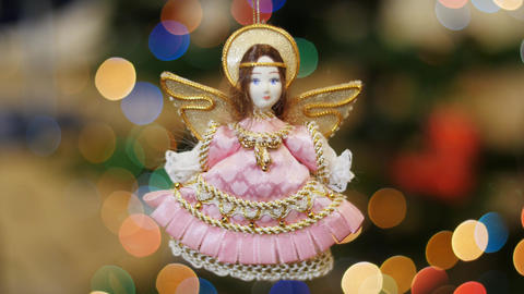 Christmas toy angel shakes at background bokeh Stock Video Footage