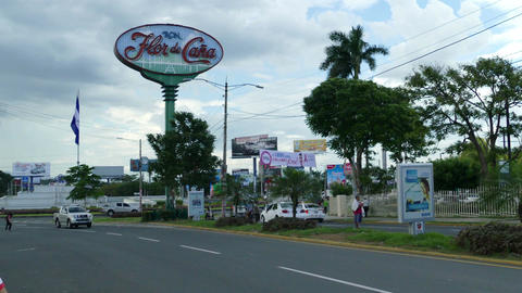 Busy street with Flor de Cana rum sign Stock Video Footage