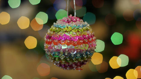 Christmas colorful ball shakes at background bokeh Stock Video Footage
