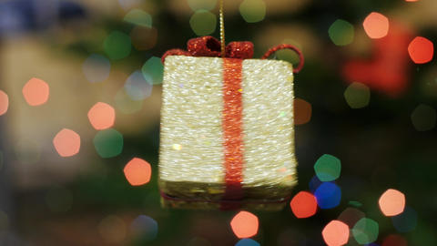 Christmas gift toy rotates at background bokeh Stock Video Footage
