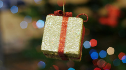 Christmas gift toy rotates at background bokeh Footage