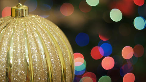 Big golden ball shakes at background bokeh Stock Video Footage