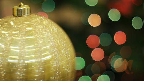 Big golden ball rotates at background bokeh Stock Video Footage