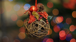 Christmas wooden toy rotates at background bokeh Footage