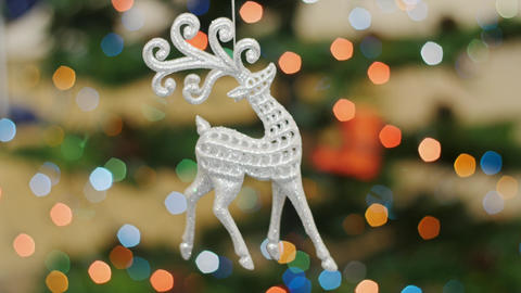 Christmas deer toy shakes at background bokeh Stock Video Footage