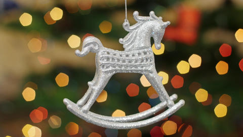 Christmas horse toy shakes at background bokeh Stock Video Footage