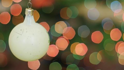 Christmas white ball rotates at background bokeh Stock Video Footage