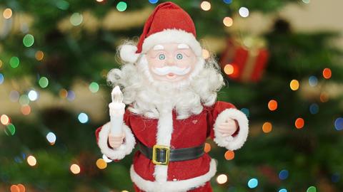 Toy Santa Claus greetings at background bokeh Footage