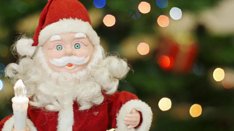 Toy Santa Claus greetings at background bokeh Stock Video Footage