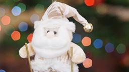 Santa Claus on skis shakes at background bokeh Stock Video Footage