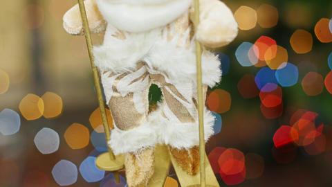 Santa Claus on skis at background bokeh. Pan Stock Video Footage