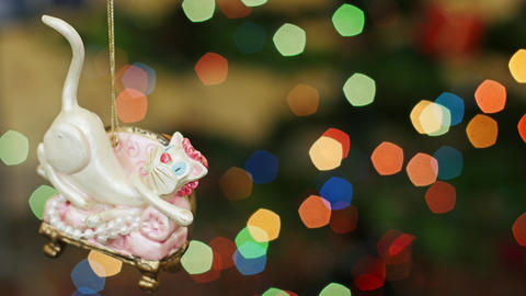 Christmas cat toy at bokeh lights. Title area Stock Video Footage