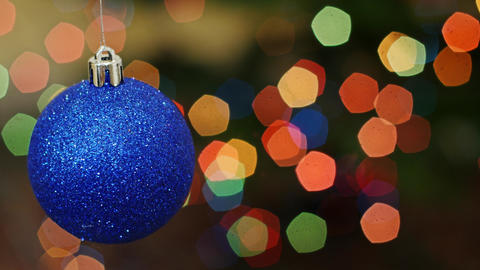 Christmas blue ball at bokeh lights. Title area Footage