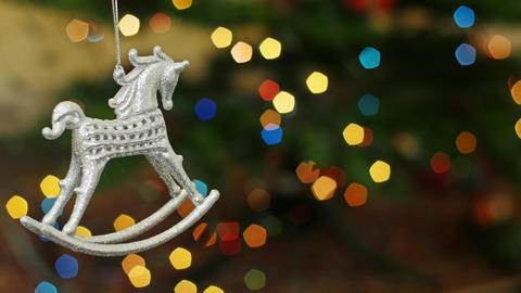 Christmas horse toy shakes at bokeh. Title area Footage