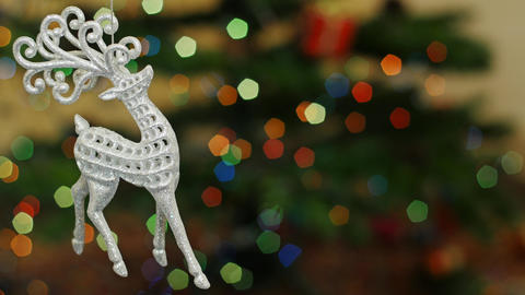 Christmas deer toy shakes at bokeh. Title area Stock Video Footage