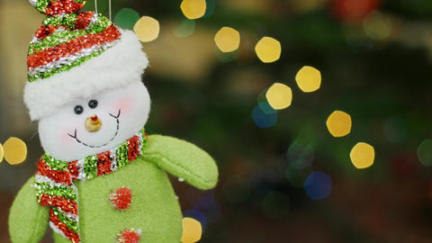 Christmas snowman toy shakes at bokeh. Title area Stock Video Footage
