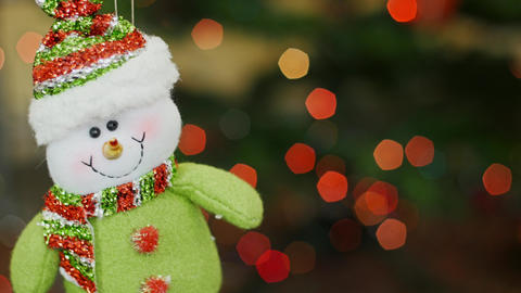 Christmas snowman toy shakes at bokeh. Title area Footage
