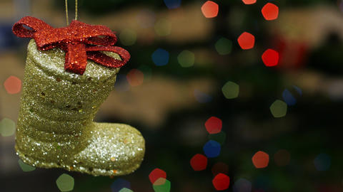 Christmas boot toy shakes at bokeh. Title area Stock Video Footage
