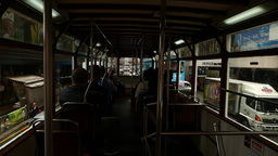 POV camera within second floor of double decker tram, dark interior, daytime Footage