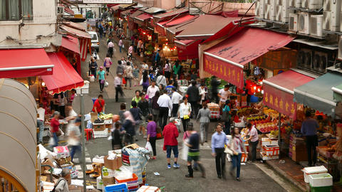 Citizens walk through street market, lively traditional marketplace TIME LAPSE Footage