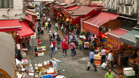 Citizens walk through street market, lively traditional... Stock Video Footage