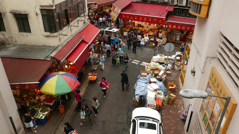 Wan Chai road intersection with Bowrington Road Market, tilt up shot Footage