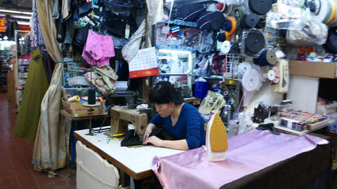 Seamstress work at market atelier workshop, chinese woman... Stock Video Footage