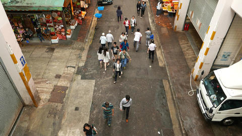Backstreet people pass through, high angle shot, tilt... Stock Video Footage