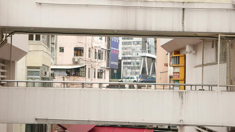 Woman pass concrete skyway, urban telephoto perspective,... Stock Video Footage