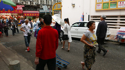 Chinese woman push loudly hand cart, street market area... Stock Video Footage