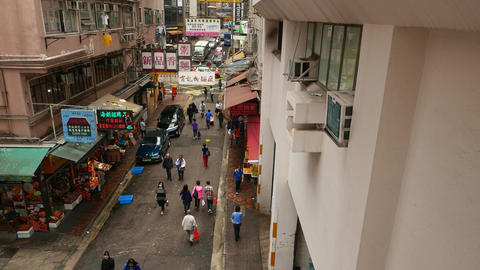 Citizens walk along Wan Chai road at Bowrington Market... Stock Video Footage