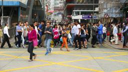 Crowd rush through crosswalk, glide dolly parallel shot,... Stock Video Footage
