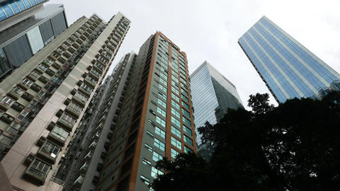 Match like apartment buildings rise up, low angle... Stock Video Footage