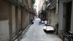 Narrow back side passage between towers at urban Causeway Bay area Footage