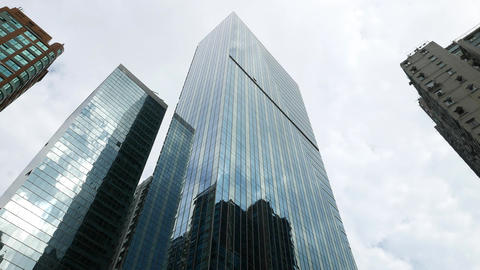 Curtain wall facade low angle shot against cloudy sky,... Stock Video Footage